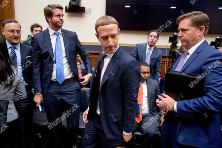 Stock Picture of Mark Zuckerberg, Kevin Martin. Facebook CEO Mark Zuckerberg, center, accompanied by Facebook vice president for U.S. public policy, Kevin Martin, right, takes a break from testimony before a House Financial Services Committee hearing on Capitol Hill in Washington, on Facebook's impact on the financial services and housing sectors