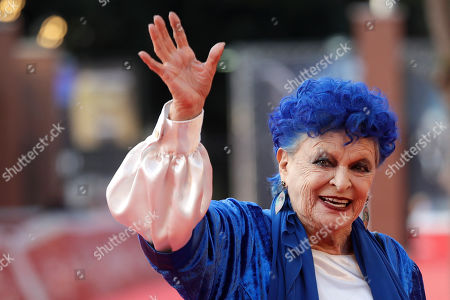 "Actress Lucia Bose waves as she arrives on the red carpet to present the book ""Lucia Bose, a biography"" by Roberto Liberatori, at the 14th edition of the Rome Film Festival"