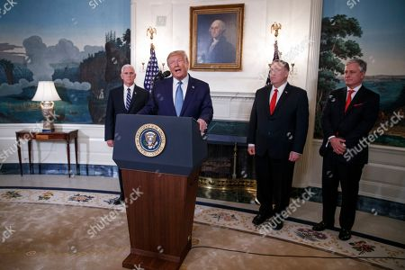 US President Donald J. Trump (2-L), with Vice President Mike Pence (L), US Secretary of State Mike Pompeo (2-R) and National Security Advisor Robert O'Brian (R), announces the lifting of sanctions on Turkey during a statement in the Diplomatic Reception Room of the White House in Washington, DC, USA, 23 October 2019. President Trump said the US will lift the October 14th sanctions on Turkey after their offensive against the Kurds in Syria calling the cease fire permanent.