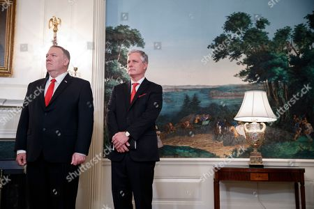 Stock Photo of US Secretary of State Mike Pompeo (L) and National Security Advisor Robert O'Brien (R) listen as US President Donald J. Trump announces the lifting of sanctions on Turkey during a statement in the Diplomatic Reception Room of the White House in Washington, DC, USA, 23 October 2019.President Trump said the US will lift the October 14th sanctions on Turkey after their offensive against the Kurds in Syria calling the cease fire permanent.