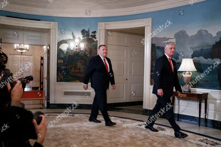 Stock Image of US Secretary of State Mike Pompeo (L) and National Security Advisor Robert O'Brien (R) walk into the Diplomatic Reception Room to listen to US President Donald J. Trump announce the lifting of sanctions on Turkey at the White House in Washington, DC, USA, 23 October 2019. President Trump said the US will lift the October 14th sanctions on Turkey after their offensive against the Kurds in Syria calling the cease fire permanent.
