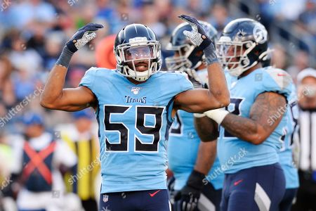 Tennessee Titans inside linebacker Wesley Woodyard (59) encourages the crowd in the second half of an NFL football game against the Los Angeles Chargers, in Nashville, Tenn