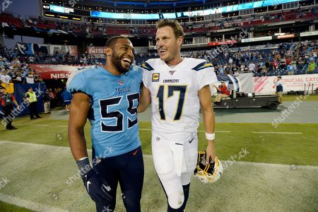 Tennessee Titans inside linebacker Wesley Woodyard (59) and Los Angeles Chargers quarterback Philip Rivers (17) talk after an NFL football game, in Nashville, Tenn. The Titans won 23-20