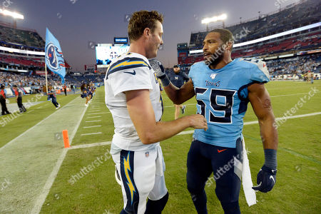 Tennessee Titans inside linebacker Wesley Woodyard (59) and Los Angeles Chargers quarterback Philip Rivers talk after an NFL football game, in Nashville, Tenn. The Titans won 23-20