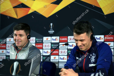 Glasgow Rangers' head coach Steven Gerrard (L) and player Ryan Jack attend a press conference at Dragao Stadium in Porto, Portugal, 23 October 2019. Glasgow Rangers will face FC Porto in their UEFA Europa League group G soccer match on 24 October 2019.