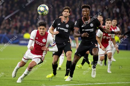 Edson Alvarez (L) of Ajax in action during the UEFA Champions League group H soccer match between Ajax and Chelsea in Amsterdam, the Netherlands, 23 October 2019.