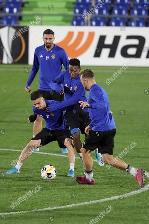 Basel's forwards Kemal Ademi (L) and Edon Zhegrova (2-L) and midfielder Eric Ramires (C) attend a training session at Coliseum Alfonso Perez stadium in Madrid, Spain, 23 October 2019. Getafe CF will face Basel during their Europa League's Group C soccer game at Coliseum Alfonso Perez stadium on 24 October 2019.
