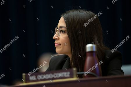 United States Representative Alexandria Ocasio-Cortez (Democrat of New York) listens during the US House Committee on Financial Services hearing with Facebook CEO, as he testifies