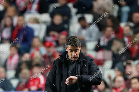 Benfica's head coach Bruno Lage looks his watch during the Champions League group G soccer match between Benfica and Olympique Lyonnais at the Luz stadium in Lisbon