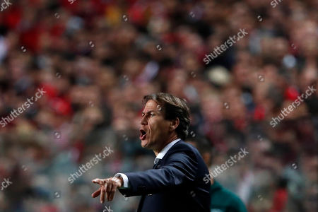 Lyon's head coach Rudi Garcia gives instructions to his players during the Champions League group G soccer match between Benfica and Olympique Lyonnais at the Luz stadium in Lisbon