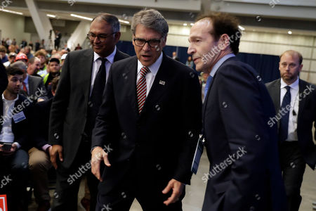 Energy Secretary Rick Perry walks with Mark Hanna of Keystone Energy, right, before President Donald Trump speaks during the 9th annual Shale Insight Conference at the David L. Lawrence Convention Center, in Pittsburgh