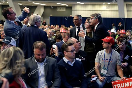 Energy Secretary Rick Perry takes a photo before President Donald Trump speaks during the 9th annual Shale Insight Conference at the David L. Lawrence Convention Center, in Pittsburgh