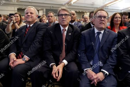 Interior Secretary David Bernhardt, left, Energy Secretary Rick Perry, center, and Environmental Protection Agency administrator Andrew Wheeler, listen as President Donald Trump speaks at the 9th annual Shale Insight Conference at the David L. Lawrence Convention Center, in Pittsburgh