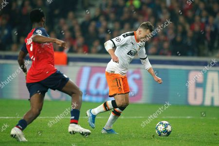 Valencia's Denis Cheryshev scores his side's first goal during the group H Champions League soccer match between Lille and Valencia at the Stade Pierre Mauroy - Villeneuve d'Ascq stadium in Lille, France