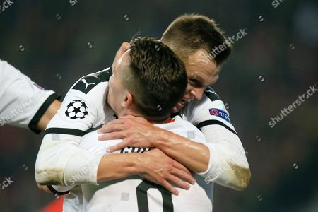 Valencia's Denis Cheryshev, right, celebrates after scoring his side's first goal during the group H Champions League soccer match between Lille and Valencia at the Stade Pierre Mauroy - Villeneuve d'Ascq stadium in Lille, France