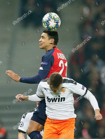 Lille's Benjamin Andre, top, jumps for a header with Valencia's Denis Cheryshev during the group H Champions League soccer match between Lille and Valencia at the Stade Pierre Mauroy - Villeneuve d'Ascq stadium in Lille, France