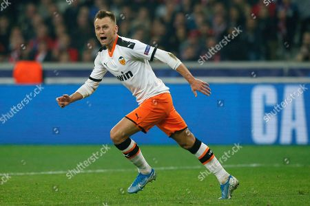 Valencia's Denis Cheryshev celebrates after scoring his side's first goal during the group H Champions League soccer match between Lille and Valencia at the Stade Pierre Mauroy - Villeneuve d'Ascq stadium in Lille, France