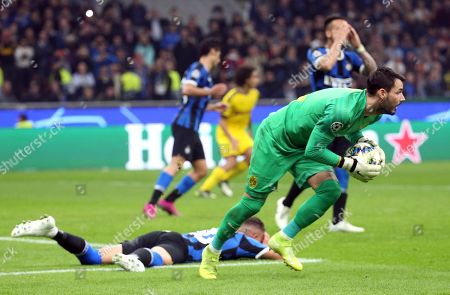 Borussia Dortmund goalkeeper Roman Burki reacts after saving a penalty during the UEFA Champions League group F soccer match between FC Inter and Borussia Dortmund at the Giuseppe Meazza stadium in Milan, Italy, 23 October  2019.