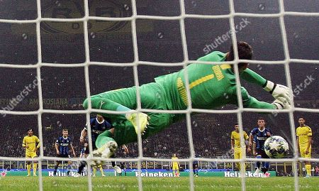 Borussia Dortmund's goalkeeper Roman Burki saves a penalty during the UEFA Champions League group F soccer match between FC Inter and Borussia Dortmund at the Giuseppe Meazza stadium in Milan, Italy, 23 October  2019.