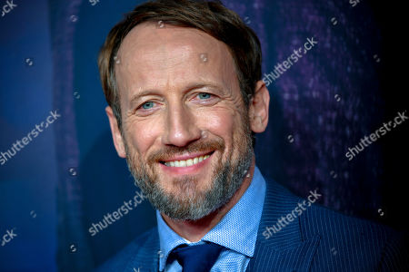 Wotan Wilke Moehring poses on the red carpet prior to the premiere of 'Das perfekte Geheimnis' (lit.: The perfect secret) in Cologne, Germany, 23 October 2019. The movie will be shown in German cinemas from 31 October 2019 on.