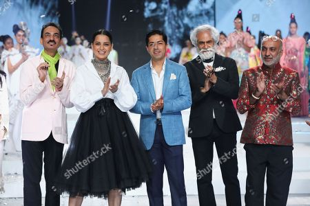 Bollywood actress Kangana Ranaut with fashion designers Wendell Rodricks, Sunil Sethi, Manish Arora and Nitin Passi on the fourth day of the FDCI's Lotus Make-up India Fashion Week at Major Dhyan Chand National Stadium.
