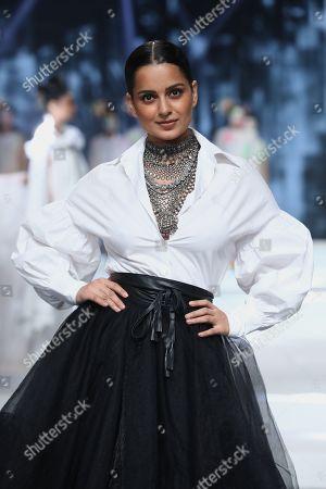 Bollywood actress Kangana Ranaut walks the ramp for fashion designer Manish Arora on the fourth day of the FDCI's Lotus Make-up India Fashion Week at Major Dhyan Chand National Stadium.