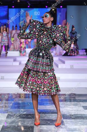 A model showcases a creation of fashion designer Manish Arora on the fourth day of the FDCI's Lotus Make-up India Fashion Week at Major Dhyan Chand National Stadium.