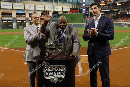 Stock Picture of Hank Aaron is flanked by Joe Torre, left, and Milwaukee Brewers Christian Yellich before Game 2 of the baseball World Series between the Houston Astros and the Washington Nationals, in Houston. Yellich is the 2019 recipient of the Hank Aaron Award