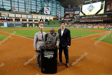 Stock Image of Hank Aaron is flanked by Joe Torre, left, and Milwaukee Brewers Christian Yellich before Game 2 of the baseball World Series between the Houston Astros and the Washington Nationals, in Houston. Yellich is the 2019 recipient of the Hank Aaron Award