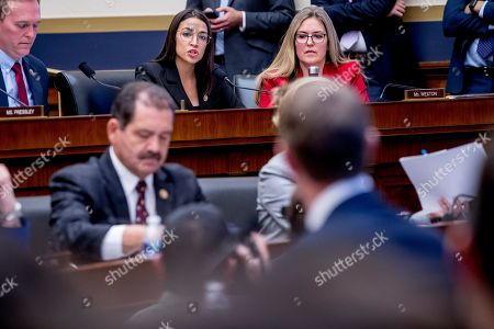 Alexandria Ocasio-Cortez, Mark Zuckerberg. Rep. Alexandria Ocasio-Cortez, D-N.Y., top center, questions Facebook CEO Mark Zuckerberg, foreground, as he appears before a House Financial Services Committee hearing on Capitol Hill in Washington, on Facebook's impact on the financial services and housing sectors
