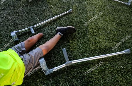 Stock Photo of Palestinian amputees exercise during a soccer training session conducted by Irish coach Simon Baker