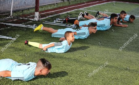 Stock Image of Palestinian amputees exercise during a soccer training session conducted by Irish coach Simon Baker