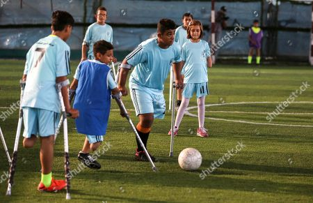 Stock Picture of Palestinian amputees exercise during a soccer training session conducted by Irish coach Simon Baker