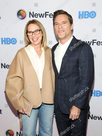 """Amy Ryan, Mike Doyle. Amy Ryan, left, and Mike Doyle, right, attend the NewFest LGBTQ film festival opening night gala screening of """"Sell By"""" at the SVA Theatre, in New York"""