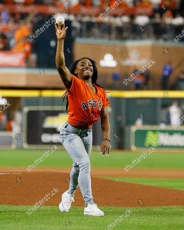 US Olympian Simone Biles throws out the ceremonial first pitch before the start of the Houston Astros and Washington Nationals  MLB 2019 World Series game two at Minute Maid Park in Houston, Texas, USA, 23 October 2019. The American League Champion Astros face the National League Champion Washington Nationals in a best-of-seven series to determine Major League Baseball's champion.