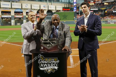Stock Photo of Baseball legend Hank Aaron (C) with Joe Torre (L) and Christian Yelich (R) during the presentation of the Hank Aaron Award before the start of the Houston Astros and Washington Nationals  MLB 2019 World Series game two at Minute Maid Park in Houston, Texas, USA, 23 October 2019. The American League Champion Astros face the National League Champion Washington Nationals in a best-of-seven series to determine Major League Baseball's champion.