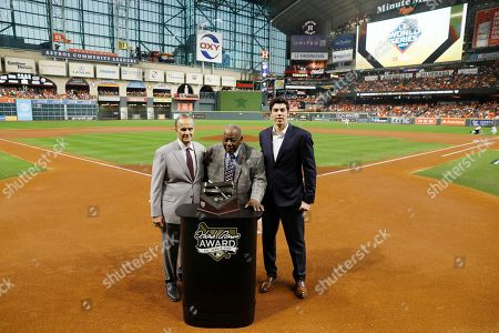 Baseball legend Hank Aaron (C) with Joe Torre (L) and Christian Yelich (R) during the presentation of the Hank Aaron Award before the start of the Houston Astros and Washington Nationals  MLB 2019 World Series game two at Minute Maid Park in Houston, Texas, USA, 23 October 2019. The American League Champion Astros face the National League Champion Washington Nationals in a best-of-seven series to determine Major League Baseball's champion.