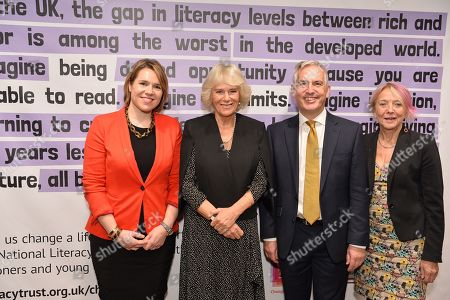 Head of Corporate Affairs, KPMG Rachel Hopcroft, Camilla Duchess of Cornwall and Chief executive, National Literacy trust Jonathon Douglas and Representative of Booker Prize foundation Dotti Irving attend a reception to mark the 7th anniversary of NLT's Books Unlocked programme at KPMG Cafe on October 24, 2019 in London, England. HRH is patron of the National Literacy Trust.
