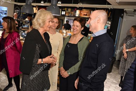 Camilla Duchess of Cornwall meets with Author, Rachel Seiffert and Author, Stephen Kelman during a reception to mark the 7th anniversary of NLT's Books Unlocked programme at KPMG Cafe on October 24, 2019 in London, England. HRH is patron of the National Literacy Trust.