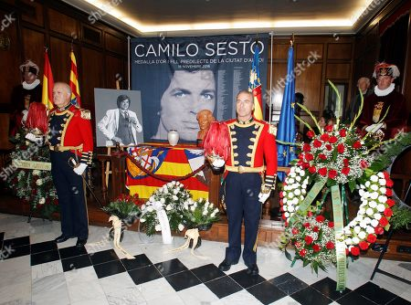 Stock Picture of Two honor guard stand guard between the ashes of late Spanish singer Camilo Sesto at the funeral chapel set in Alcoy, the singer home town, eastern Spain, 24 October 2019. The singer, who sold more than 100 million of copies of his works, died in Madrid, last 08 September.