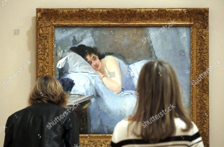 Two women observe the artwork 'Girl upon awakening' by Spanish artist Eva Gonzalez, during the presentation of the exposition 'Masterpieces of the Kunsthalle Brenen: From Delacoix to Beckamm' at the Guggenheim Museum in Bilbao, Basque Country, northern Spain, 24 October 2019. The exhibition, running from 25 October to 16 February 2020, presents artworks of the nineteenth and twentieth centuries owned by Kunsthalle Museum in Bremen (Germany), to highlight how the Kunsthalle?s collection was influenced by contemporary discourses on modern art and its early reception in Germany, the country that first embraced Impressionism and Post Impressionism.