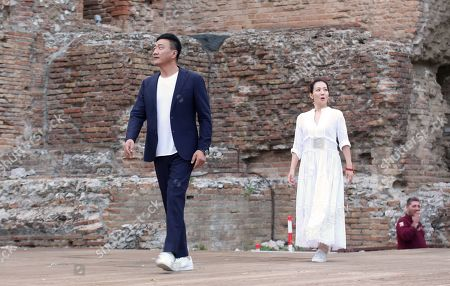 Hu Jun visiting the Greek theatre with wife Fang Lu