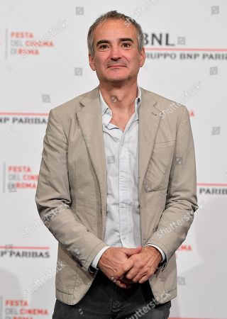 Olivier Assayas poses during a photocall at the 14th annual Rome Film Festival, in Rome, Italy, 24 October 2019. The film festival runs from 17 to 27 October.