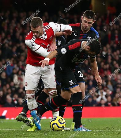 Calum Chambers of Arsenal pushes Luka Milivojevic of Crystal Palace which leads to VAR consulted and disallowed Sokratis of Arsenal goal