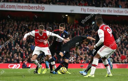 Calum Chambers of Arsenal pushes Luka Milivojevic of Crystal Palace in penalty box  which leads to VAR consulted and  disallowed Sokratis of Arsenal goal