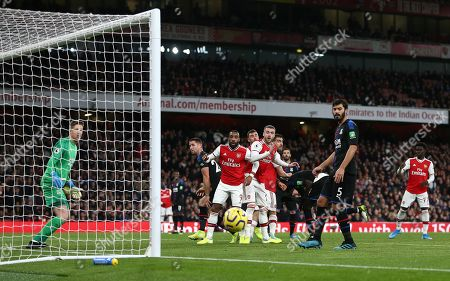 Alexandre Lacazette of Arsenal and Calum Chambers of Arsenal  watch the ball goes past the goal post