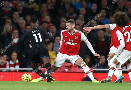 Wilfried Zaha of Crystal Palace is fouled by Calum Chambers of Arsenal - penalty