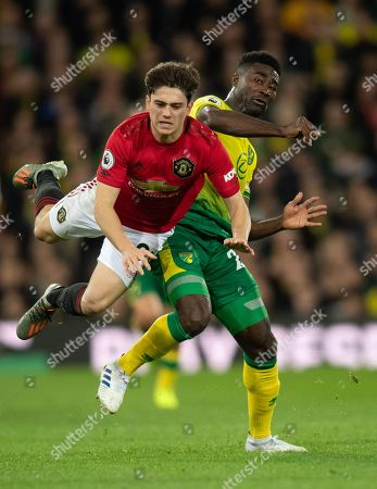 Alexander Tettey of Norwich City upends Daniel James of Manchester United