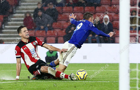Jamie Vardy of Leicester City is fouled by Jan Bednarek of Southampton for a penalty.