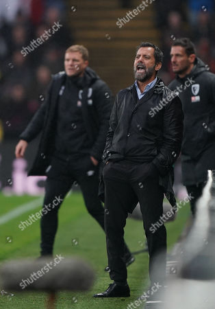 Quique Flores, manager of Watford and Bournemouth manager Eddie Howe on the touchline